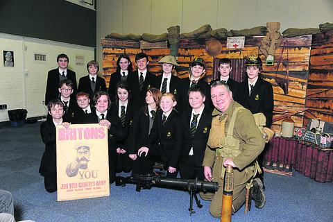 This Is Wiltshire: First World War expert Steve Williams explains some of the conflict's weaponry, including heavy rifles, to Year Eight pupils at Clarendon College during his workshop
