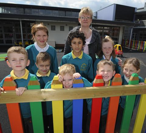 This Is Wiltshire: Trinity School head Catherine Davis with youngsters