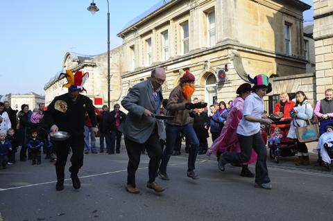 This Is Wiltshire: Pancake racers at last year's event in Chippenham