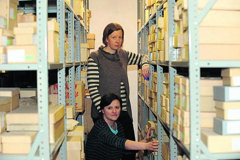 This Is Wiltshire: Curator Lisa Brown with assistant curator Heather Ault and tons of artefacts in boxes