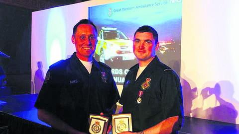 Paramedic Ross Culligan, left, and clinical team leader Richard Miller with their award