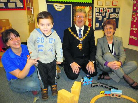 This Is Wiltshire: Staff member Michaela Smith with pupil Ben, mayor Kelvin Nash and his wife Pam