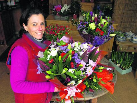 This Is Wiltshire: Pewsey florist Joanna Freeman advises men to steer away from bunches of red roses on Valentine's Day because they are so expensive