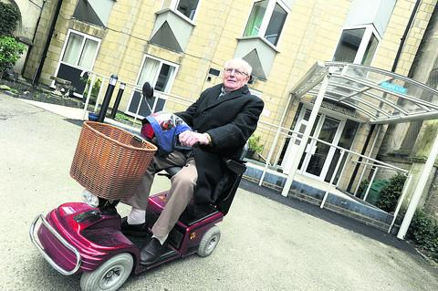 This Is Wiltshire: Wilfred Davison on his mobility scooter, none the worse for his adventure