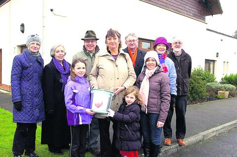 This Is Wiltshire: Paula Edwards, centre, and supporters are raising money for a defibrillator in Derry Hill