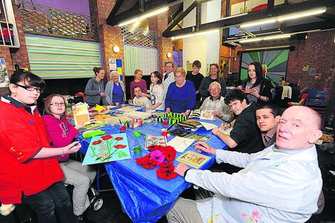 This Is Wiltshire: Youngsters from Melksham Oak work with senior citizens on an art project at the Youth Development centre in Spa Road Melksham