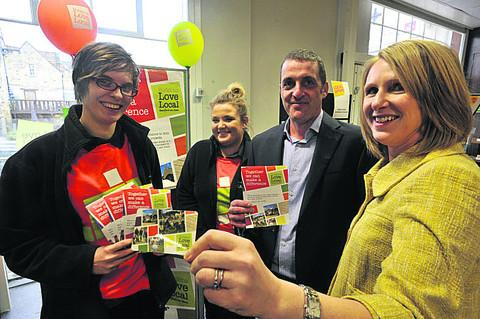 This Is Wiltshire: Mark Richardson, of Budgens in Bradford on Avon, ready to start Love Local, and staff Annie Holland and Sophie Dobson, left, with Jennifer Green, right, the fundraising manager for Dorothy House