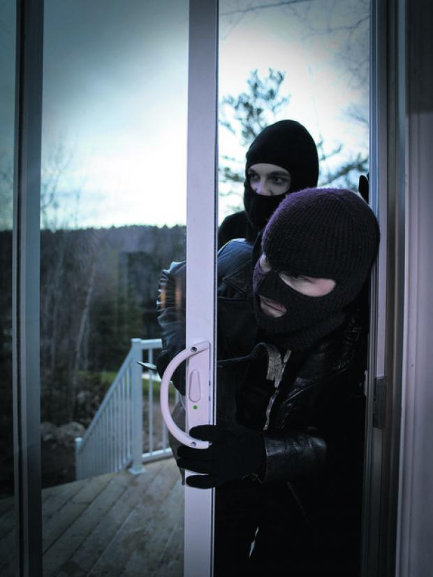 This Is Wiltshire: Two burglars entering a home. Pictured posed by models