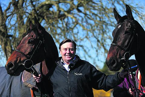 This Is Wiltshire: Trainer Nicky Henderson with Bobs Worth (left) and Long Run (right) at Seven Barrows in Lambourn today