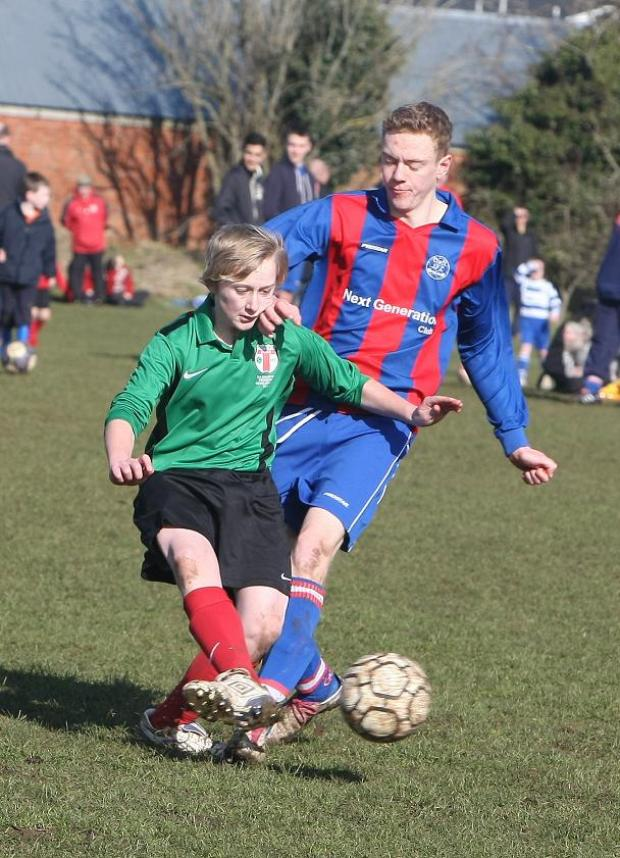 This Is Wiltshire: Croft's Jacob Wilts, right, puts a tackle in against Highworth's Jay Fenwick