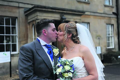 This Is Wiltshire: James and Lisa celebrate with a kiss on their wedding day