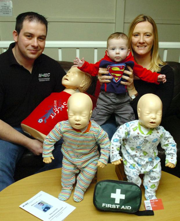 This Is Wiltshire: Matt and Anna Johnstone at Scoffs Cafe in Chippenham with six-month-old son Ben and some of the first aid training equipment they've been using.                     .