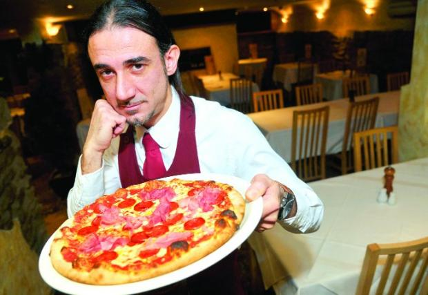 This Is Wiltshire: FOOTBALLERS' FAVOURITE Vincenzo De Iure with a Di Canio pizza at Fratello's restaurant in Regent Circus    	                     Picture: JAMES DOUGLAS
