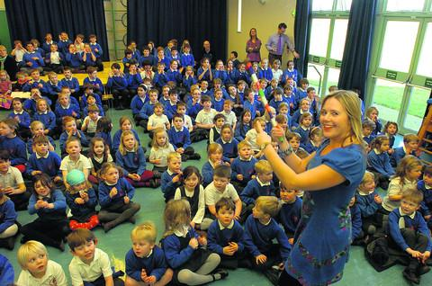 Debbie Liddle, deputy headteacher of Sherston School, sings along with the pupils during the event
