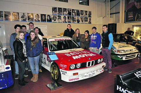 This Is Wiltshire: Motorsport students gather in the heritage centre at Prodrive, ready for a racing history lesson