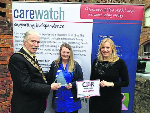 John Knight, the mayor of Trowbridge, and care manager Jessica Walder present the award to Rose Scarff, centre