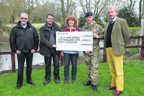 This Is Wiltshire: Diane Powell, centre, of Help for Heroes, with, from left, metal detectors Terry Ely and Allan Ashford, Michael Whitehead, of Chisbury Lower Farm, and Richard Drew, of The Crown Estate