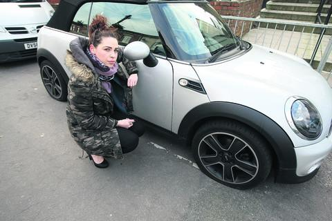 Kayleigh Hall, of Dixon Street, with her car which had all four tyres slashed