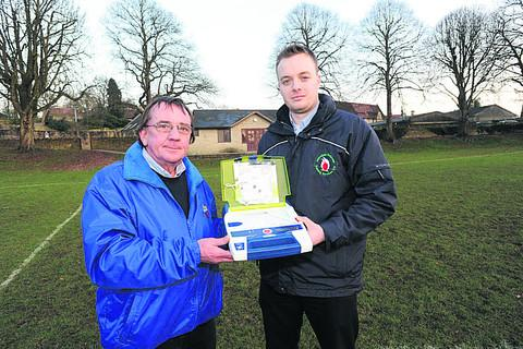 This Is Wiltshire: Bradford Youth football club chairman Nick Maw with Chris Maitland of Immediate Response Training Services with a defibrillator