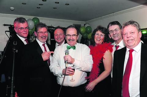 This Is Wiltshire: Alan Cane, fourth left, with the band Gypsy and guests at the fundraising ball