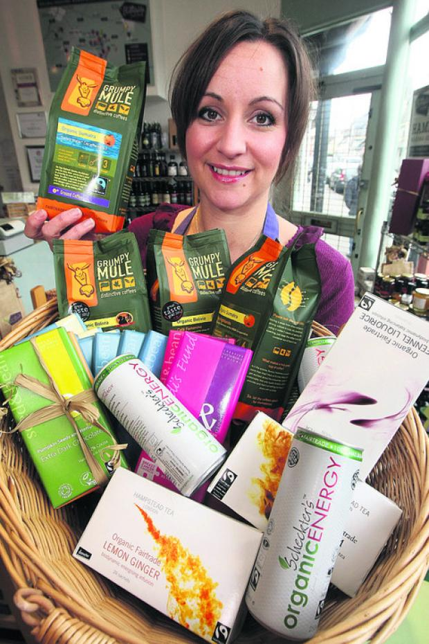 This Is Wiltshire: Laura May from Bloomfields Fine Food in Highworth with some of the Fairtrade items the shop sells
