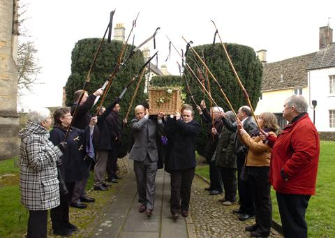 This Is Wiltshire: Colleagues of Tony Knowler form an arch for his coffin with their bows