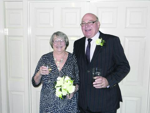 This Is Wiltshire: Brian and Pam Reed toast their golden wedding anniversary.
