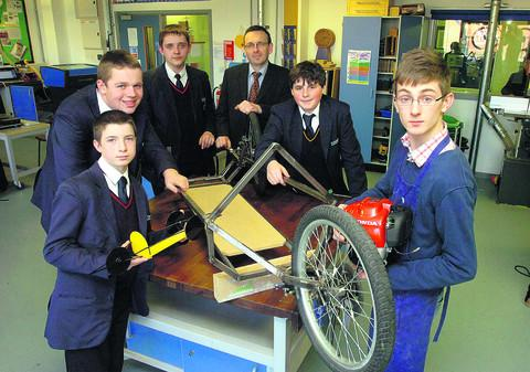 Design and technology teacher Clive Stell with pupils Bradley Mason, Matt Jones, Dan Snipe, Tom Maslin and Euan Humphreys and their eco car