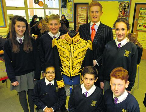 This Is Wiltshire: Matt Crocker, from Gieves & Hawkes, and Sheldon School pupils (back row, from left) Amelia Walters, Tom Tennant and Chloe Jefferies, and (front) Renee Keill, Nick Pasi and Harry Kershaw with Michael Jackson's £76,000 jacket