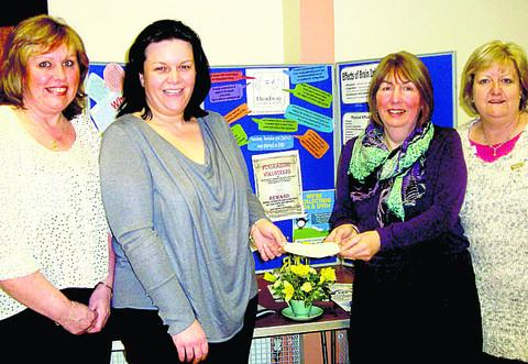 Sheryl Edwards and Alison Burton receive Wootton Bassett Flower Club's £200 cheque for Headway Swindon & District from Jan Chambers and Anne Tuffin