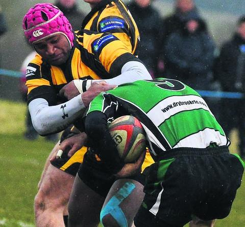 Marlborough fly-half Amori Nailago gets to grips with Drybrook's Carl Moore