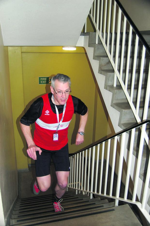 Darren Wrintmore on one of his training runs up the office stairs