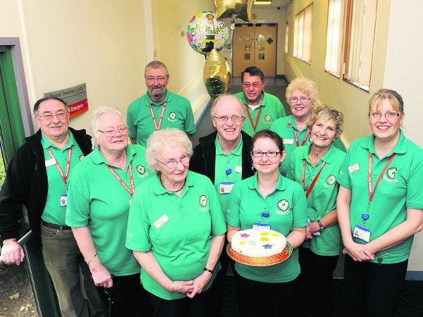 This Is Wiltshire: Celelbrating The team of volunteers who man the audiology support desk at GWH, with the cake they enjoyed to mark their two years of service Picture: SIOBHAN BOYLE
