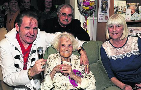 Nora Greenwood celebrating her 100th birthday with 'Elvis', her son John Greenwood and daughter Gillian Usher