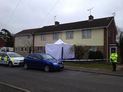 Police at the scene of the deaths in Moonraker, Devizes