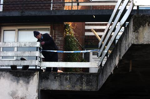 A worker on the balcony where the man fell