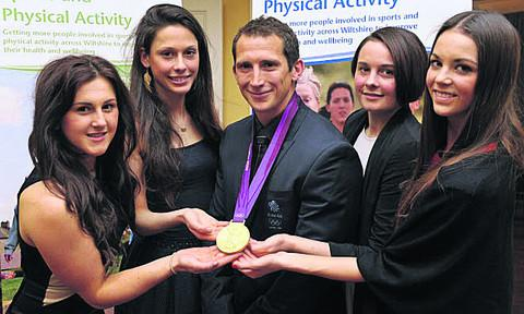 This Is Wiltshire: Grant recipients (l-r) Hannah Grubb (Hilperton, pole vault) Hannah Drewett (Salisbury, triathlon), Jemima Duxberry (Devizes, judo) and Laura Halford (Cricklade, rhythmic gymnastics) with Olympic gold medallist Ed McKeever