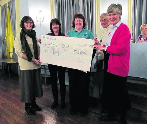 Pam Bacon, centre, of Naomi House, receives £750 from Devizes Floral Club members Sally Bullock, Eileen Eagle, Gill Thompson, outgoing chairman, and Val Prior, new chairman
