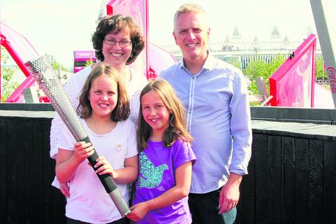 Vicky Philpott with her husband Ian and daughters Mollie and Harriet. I