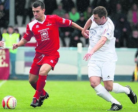 Chippenham are hoping to re-sign Lewis Powell (left) from Frome