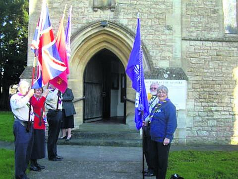 Scout fellowship members outside Southwick Church with their standards