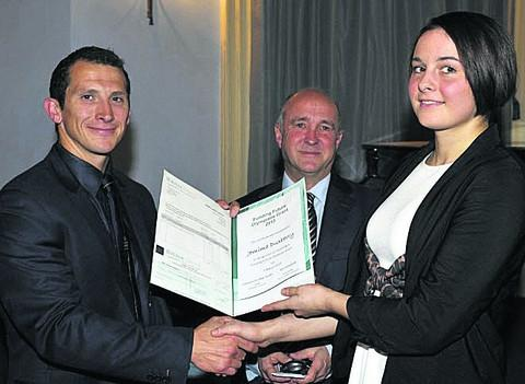 Devizes judoka Jemima Duxberry (right) receives her £1,000 grant award from Olympic gold medallist Ed McKeever (left) and Coun Jerry Kunkler