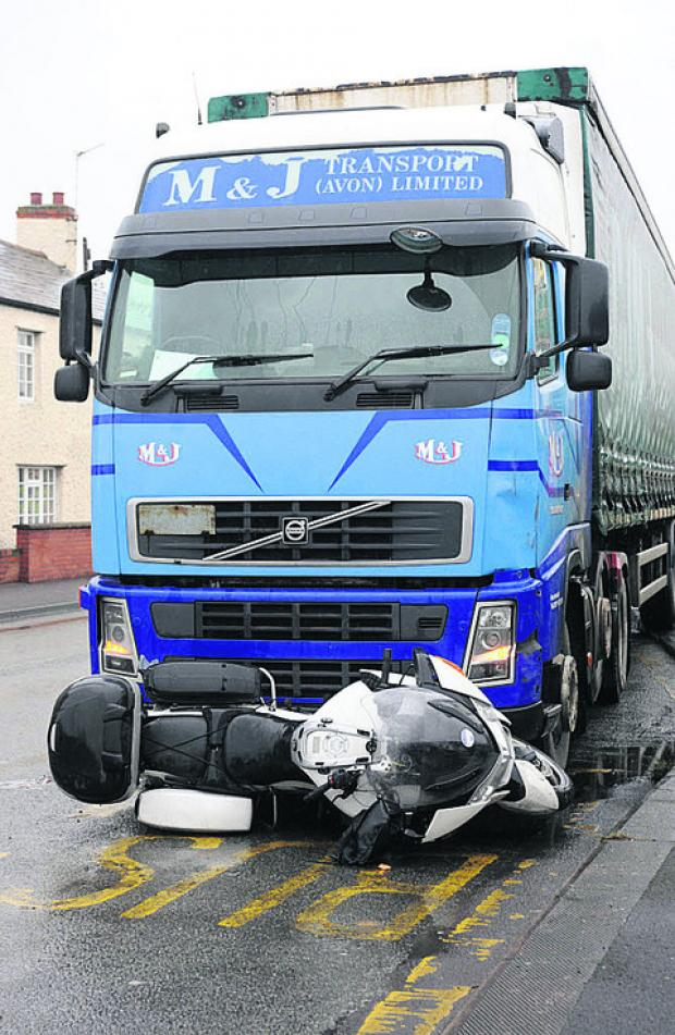 This Is Wiltshire: The BMW motorbike wedged under the grille of the lorry cab