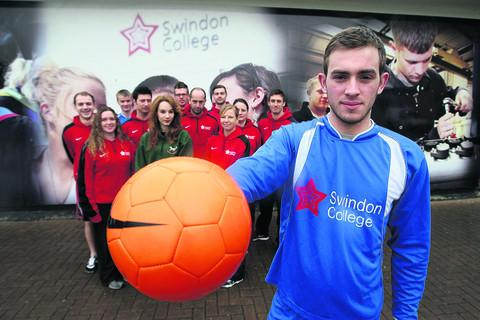 Ben Tanner, front, with other students and staff at Swindon College