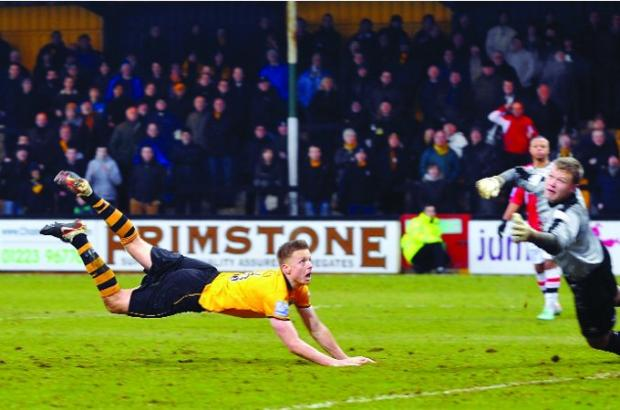 THE WINNER Tom Shaw's goal for Cambridge United against Woking won a Swindon punter nearly £90,000