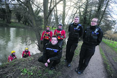 The rescue team (in the water), firefighters Dave Bishop and Nick Ratcliffe; back row, Chippenham fire crew manager Rob Evans, left, and watch manager Steve Lodge; front row, from left, Sgt Louis McCoy, PCSO Ali Duncan and PCSO Lil Duncan