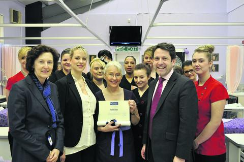 This Is Wiltshire: From left, Wiltshire College principal Di Dale, Stacey Coulson (SW company trainer for the International Institute of Anti-Ageing, who presented the award), beauty therapy programme leader Heather Terrington, MP Duncan Hames and beauty therapy students