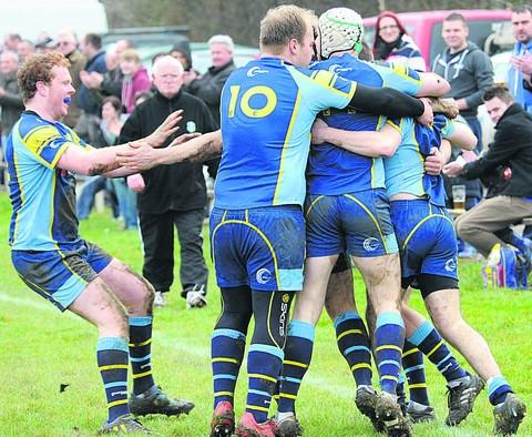Trowbridge players celebrate the first of  winger Davies' two first-half tries against Devizes