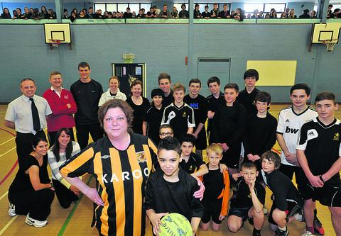 It was teachers versus pupils in a fundraising football match at Clarendon Academy, with teachers captained by Nancy Howell and pupils by Brandon Daley, both front centre
