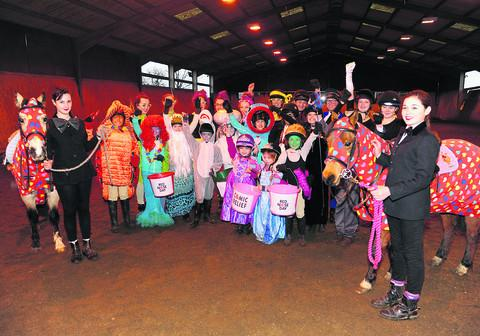 This Is Wiltshire: Riders taking part in a fancy dress dressage display at Wickstead Farm, Highworth, in aid of Comic Relief